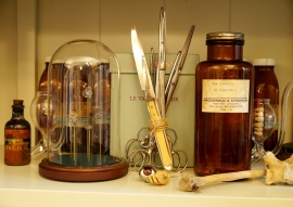Antique autopsy instruments and a collection of bones, bullets and bottles